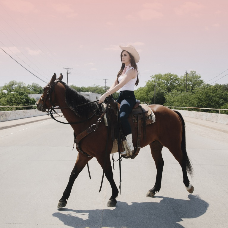 KACEY MUSGRAVES PARTNERS WITH LUCCHESE BOOTS.
