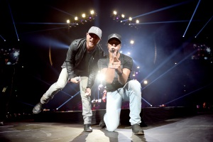 "NASHVILLE, TN - MAY 06:  Singer-songwriters Cole Swindell (L) and Luke Bryan (R) perform on stage and Kicks off the ""Huntin', Fishin' And Lovin' Every Day"" Tour at Bridgestone Arena on May 6, 2017 in Nashville, Tennessee.  (Photo by John Shearer/Getty Images for Schmidt PR) *** Local Caption *** Luke Bryan;Cole Swindell"