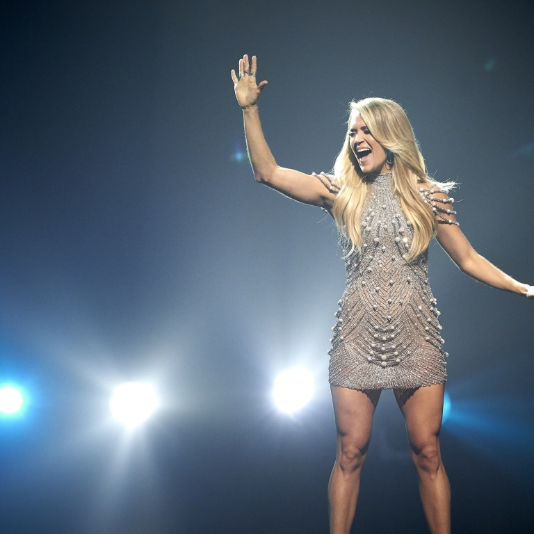 CARRIE UNDERWOOD LOOKS FORWARD TO SUNDAY NIGHTS AND FOOTBALL.
