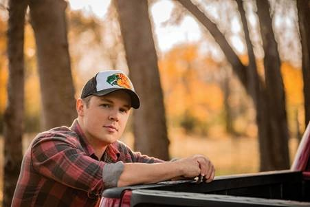 NEWCOMER TRAVIS DENNING SET TO JOIN JUSTIN MOORE ON TOUR.