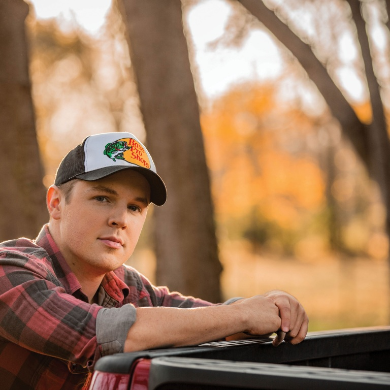 TRAVIS DENNING HEARS HIS DEBUT SONG ON THE RADIO FOR THE FIRST TIME.
