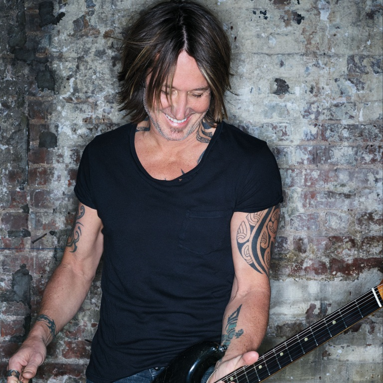 "KEITH URBAN RELEASES HIS NEW SINGLE, ""NEVER COMING' DOWN."""