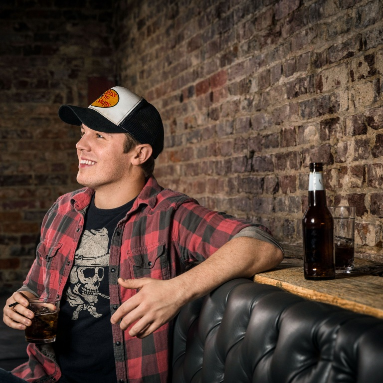 TRAVIS DENNING THANKS JUSTIN MOORE FOR BELIEVING IN HIM.